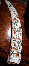 Chinese Famille Rose Porcelain Tusk With Peach Tree Decoration. 30cm in Length