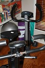 Two Exercise Bikes Together With Gym Equipment