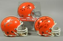 Three Cleveland Browns Signed Mini Helmets