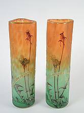 DAUM.  Rare paire de vases en verre gravé émaillé et légendé 'comme la plume au vent', col de forme triangulaire, signés.
