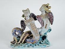 R.BUTHAUD.  Groupe en céramique polychrome 'Les deux sirènes'.