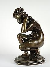 CARPEAUX 'Flora accroupie'. Sculpture en bronze à patine brune, fonte Susse Frères, signée. H. 52 cm