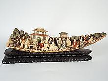 Défense en ivoire sculpté et polychrome à décor de scènes villageoises. (Elephantidae spp),