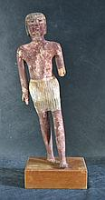 An Egyptian Painted Burial Figure of an Official