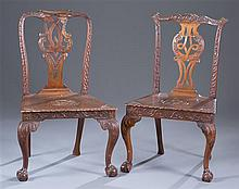 Assembled Pair of George III Carved Mahogany Hall Chairs
