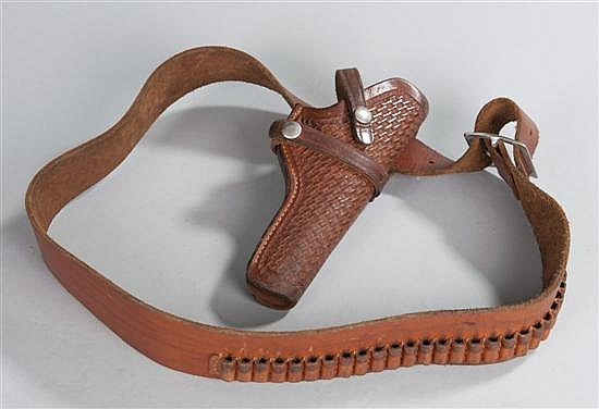 Leather holster for civilian use with waist belt having cartridge loops. Attractive tooled surface to holster face.