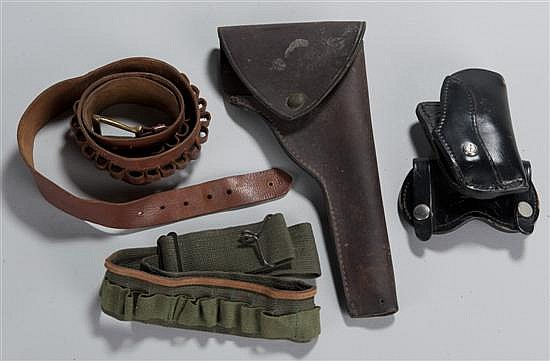 Lot of leather holsters and cartridge belts.