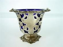 A VICTORIAN SILVER BASKET, pierced form with floral border, blue glass inlay. Swing handle missing a/f. Possibly EB (mark obscured)...