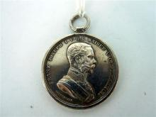 A SILVER 'DER TAPFERKEIT' MEDAL awarded by the Austro-Hungarian military for bravery.