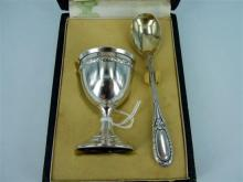 A FRENCH GILDED SILVER EGG CUP AND SPOON. Boxed.