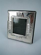 A SMALL SILVER PHOTOGRAPH FRAME. Image 4 x 3.5cm.