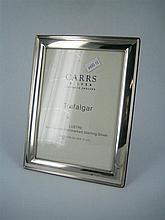 A SILVER PHOTOGRAPH FRAME; Carrs, Sheffield. Image 17 x 12cm.
