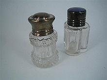 TWO SILVER-CAPPED PERFUME BOTTLE, one with lilac translucent enamel screw cap and trefoil-section glass body. (2)