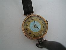 A 9ct CASED LADY'S WRISTWATCH.