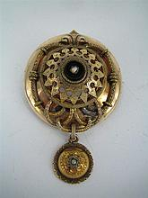 A VICTORIAN STYLE 14k GOLD TARGET BROOCH with pearl and onyx centre and applied motifs; metal pin.