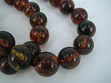 A BALTIC AMBER BEAD ROPE, 15.5mm beads strung and knotted.