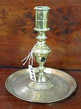 A 17th CENTURY ENGLISH BRASS CHAMBER CANDLESTICK. Height 15cm.