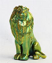 AN ART DECO LION FIGURE, by Zsolany.