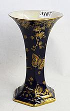 A CROWN DUCAL WARE VASE, Cobalt lustre with birds and butterfly design. Circa 1930. Height 18cm.