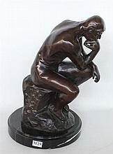 'THE THINKER' bronzed sculpture, on black marble base. Height 40cm.