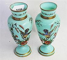 A PAIR OF VICTORIAN TURQUOISE OPAL GLASS VASES of baluster form, painted with birds and foliage and heightened in gilt. Height 23cm.