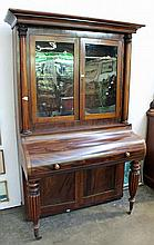 A VICTORIAN MAHOGANY PARLOUR CABINET, with glazed doors and writing section below.