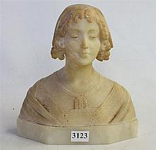 AN ALABASTER CARVED BUST OF A YOUNG WOMAN wearing a bonnet, on base. Height 20cm