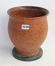A POTTERY VASE, orange design. Height 20cm. Circa 1920-40.