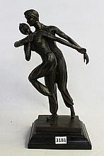 A BRASS FIGURE GROUP 'PERSIAN DANCERS' after the original by Demetre Chiparus, 20th century, signed D.H. Chiparus to the stepped mar.