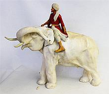 A TALL ELEPHANT FIGURE, a sultan riding it (a/f).