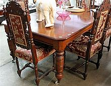 A LATE VICTORIAN MAHOGANY DINING TABLE, fitted one leaf and raised on turned legs.