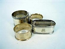 FOUR SERVIETTE RINGS, three silver, one silver-plate. (4)