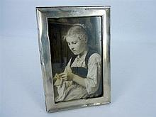 A SILVER PHOTO FRAME with wooden backing by J&R Griffin, Chester, 1914.