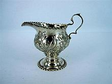 A SILVER DECORATIVE MILK JUG WITH BEADED BORDER by George Nathan & Ridley Hayes, Chester, 1904.