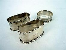 THREE SILVER NAPKINS RINGS. A pair made by Adie Brothers, Birmingham, 1950 and a single ring  by Henry Griffith & Sons Ltd, Birmingh...
