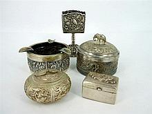 A GROUP OF ASSORTED SILVER PIECES (5) including two lidded boxes, a matchbox holder and an ashtray with cigarette rests.