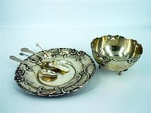 A GROUP OF SILVER (6) including a decorative floral plate, footed bon bon dish and four teaspoons.