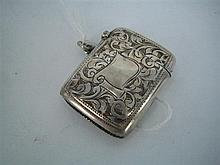 A SILVER MATCH CASE engraved with scrolls and with vacant cartouche; A.J., Birmingham 1913.