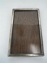 A SILVER PHOTOGRAPH FRAME, plain rectangular, with oak backing; marked Kangaroo/S/Kangaroo. Height 22cm.