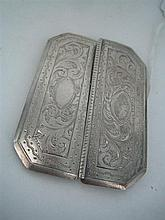 A SILVER BUCKLE, rectangular with canted corners, in halves, engraved with scrolls; marked Goldsmiths Hall Coy, Stg Silver. 7 x 5.3cm.