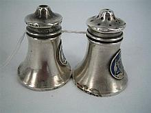 A PAIR OF AUSTRALIAN SILVER SALT AND PEPPER SHAKERS, enamelled Australian Coat of Arms applied; Tipping & Lawdon. Height 4.5cm.