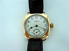 A GENTLEMAN'S WALTHAM WRIST-WATCH; cushion-shape rolled-gold case, Arabic numeral white enamel dial with red '12', and subsidiary se
