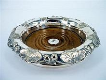 A DECORATIVE SILVER AND WOODEN WINE DECANTER STAND (unmarked)