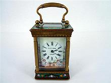 AN ELLIOT & SON CARRIAGE CLOCK WITH ENAMEL DECORATION
