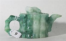 A CHINESE JADE TEAPOT, carved with high relief bamboo design. ht. 8.5cm.