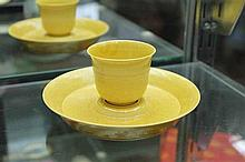 A YELLOW CUP AND SAUCER, Qianlong mark to base.