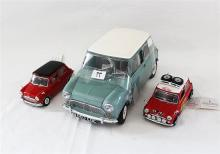 A SUNSTAR 1961 AUSTIN COOPER 1:12, and two Morris Mini Coopers by Franklin Mint.