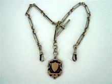 † AN EDWARD VII SILVER FOB CHAIN, shield medallion with vacant cartouche; Thomas Fattorini, Birmingham, 1906. Weight 47.5g.
