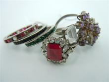 A GROUP OF SIX SILVER AND COLOURED STONE RINGS. Weight 16.2g. (6)