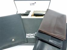 A MONT BLANC PEN AND FOUR LEATHER WALLETS, Mont Blanc pen with two ink cartridges (boxed). Three leather wallets by Louis Cardini an...